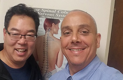 Chiropractor Flushing NY Michael Rogers with Happy Patient